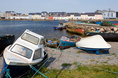 Galway boats, Ireland. Boats on land with Galway houses in the background, Ireland Stock Photography