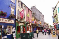 One cute street in Galway. Galway is a city in the West of Ireland in the province of Connacht. Galway lies on the River Corrib between Lough Corrib and Galway royalty free stock images