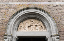 Frieze above Saint Mary s Church in Galway, Ireland. Galway, Ireland - August 3, 2017: Beige frieze above the entrance door of Saint Mary's Church shows Mary royalty free stock photo