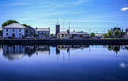 Galway. A part of the city of Galway reflected in the water with surreal colors and confusion between the above and below looks like a painting royalty free stock photos