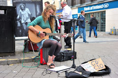 Galway Shop Street, August 2016,Irish Girl Playing Music in A St. Reet Performance Royalty Free Stock Photo