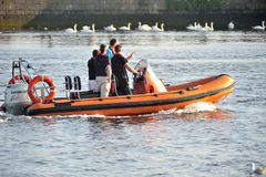 Galway Spanish Arch , Ireland June 2017,River Corrib , Group of. People Sailling a Inflatable boat with motor Royalty Free Stock Image