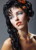 σγουρή σύγχρονη γυναίκα &gam Στοκ Εικόνες