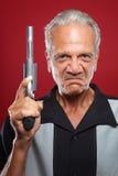 Gamal man med en Revolver royaltyfri fotografi