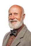 Gamal man med ett stort skägg och ett leende Royaltyfria Foton