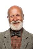 Gamal man med ett stort skägg och ett leende Arkivbilder
