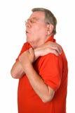 Gamal man med reumatiker smärtar Arkivfoto