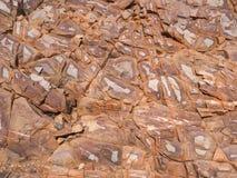 Gamas del oeste de MacDonnell de la superficie roja de la roca Imágenes de archivo libres de regalías
