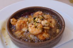 Gambas Al Ajillo - traditional spanish food. Shrimps fried in garlic oil with herbs and spices Stock Image