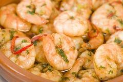 Gambas Pil Pil. Sizzling prawns with chili and garlic. Traditional Spanish tapas dish Royalty Free Stock Photo
