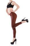 Gambe della donna che indossano le calze lunghe isolate Immagine Stock