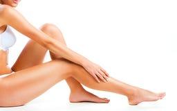 Gambe della donna su bianco Fotografia Stock