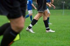 Gambe di calcio Fotografia Stock