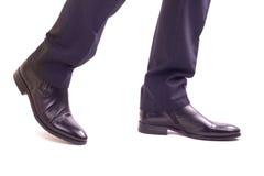 Gambe di camminata dell'uomo d'affari Immagine Stock