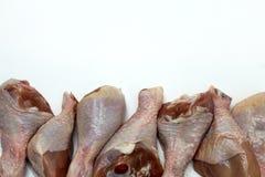 Gambe di pollo crude su fondo bianco Fotografia Stock Libera da Diritti