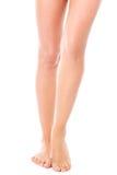 Gambe femminili esili di bellezza, isolate Fotografia Stock Libera da Diritti