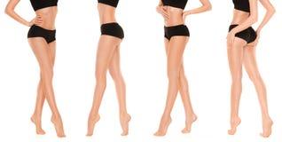 Gambe graziose lunghe della donna su fondo bianco Immagine Stock Libera da Diritti