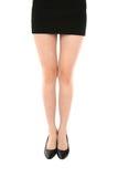 Gambe snelle della donna attraente su fondo bianco Immagine Stock