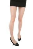 Gambe snelle della donna attraente su fondo bianco Immagini Stock