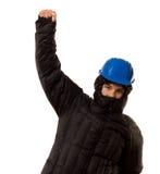Gamberro joven que perfora el aire con su puño Foto de archivo
