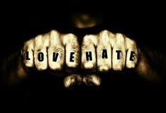 Gamberros amor y puños del tatuaje del odio imagen de archivo