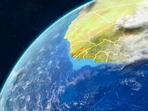 Gambia on Earth with borders. Gambia on realistic model of planet Earth with country borders and very detailed planet surface and clouds. 3D illustration royalty free stock photography
