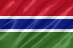 Gambia Flag. With waving on satin texture royalty free stock image