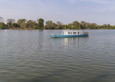 Gambia river. Small ship sailing on the river Gambia. West Africa royalty free stock photos