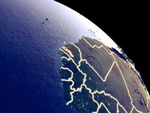 Gambia from space. Gambia at night from orbit. Plastic planet surface with visible city lights. 3D illustration. Elements of this image furnished by NASA vector illustration
