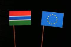 Gambian flag with European Union EU flag isolated on black. Background Royalty Free Stock Photos