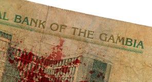 10 Gambianer-Dalasibanknote, blutig Stockfotografie