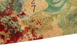 10 Gambianer-Dalasibanknote, blutig Lizenzfreie Stockbilder
