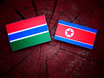 Gambijska flaga z koreańczyk z korei północnej flaga na drzewnym fiszorku Zdjęcia Stock