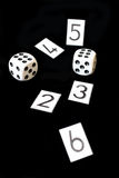 Gamble. Two dices and numbers on a black background stock photo