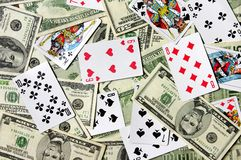 Gamble. Dollar banknotes and playing cards Stock Images