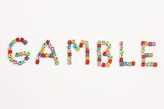 Gamble. Word Gamble made of colorful dices Stock Photography
