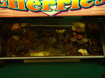 Gamble. Slot machine filled with coins Royalty Free Stock Image