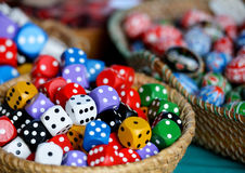 Gamble cubes. Colourful gamle cubes in the basket Royalty Free Stock Photo