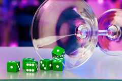 Gamble dice and cocktail martini glass Stock Images