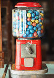 Gamble eggs in vintage gumball machine at grocery store. Gamble eggs in vintage gumball machine on glass counter at grocery store stock photography