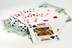 Gamble with playing cards and two dices Stock Photography