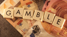 Gamble. The text gamble on money, above a stone plate Royalty Free Illustration