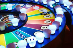 Gamble wheel win time. Colorful gamble wheel with text of WIN and a 'smile light Royalty Free Stock Photo