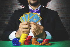 Gambler with cards and chip Royalty Free Stock Image