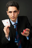Gambler with cards and chips. Stock Images