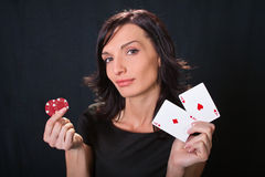 Gambler with cards and chips. Royalty Free Stock Images