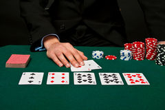 Gambler with cards and chips. Royalty Free Stock Image