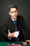 Gambler with cards and chips. Royalty Free Stock Photos