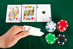 Gambler with cards and chips. Stock Photo