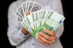 Gambler with cards and euro money banknotes Stock Images